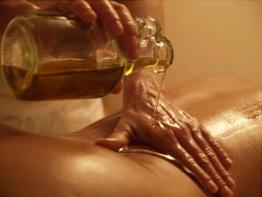 massage warme olie